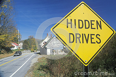 A sign that reads Hidden Drives Editorial Photography