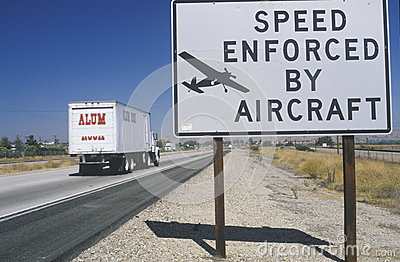 A sign that reads Speed enforced by aircraft Editorial Stock Image