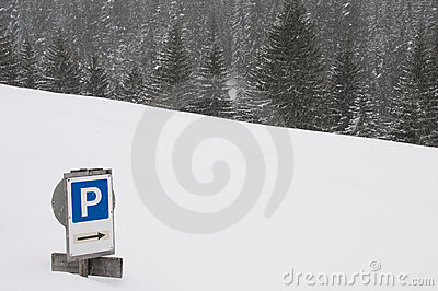 Sign to car park coved with snow