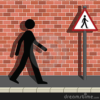 Signage Man Walking Along a Street
