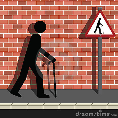 Signage Old Man Walking Along a Street