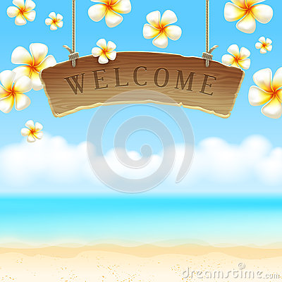 Signboard Welcome anf flowers on tropical beach