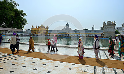 Sikh walking in the Golden Temple, Amritsar Editorial Image