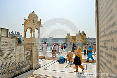Sikh walking and praying in the Golden Temple, Amritsar Editorial Photo