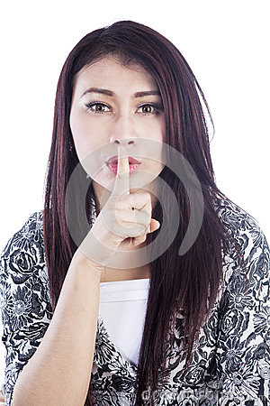 Silent expression of woman isolated over white