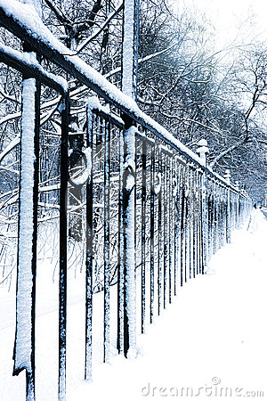 Silent snow-covered urban park in winter