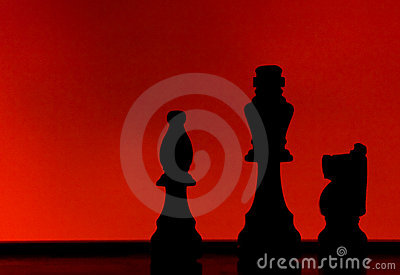 Silhouette of 3 chess pieces