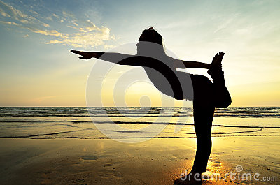 Silhouette Asian woman practicing yoga