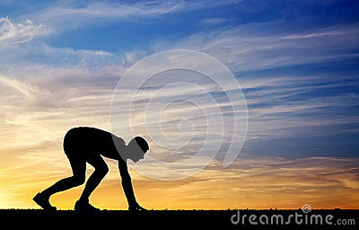 Silhouette of athlete in position to run