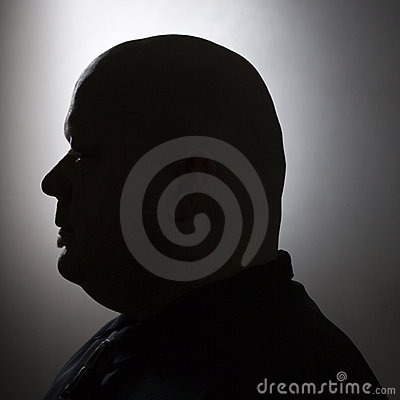 Silhouette of bald man.