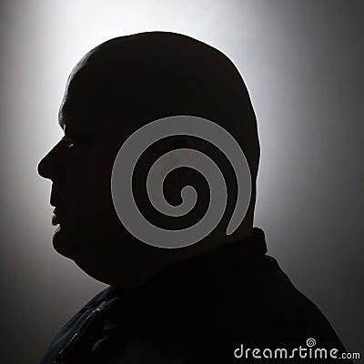 Silhouette of bald man.