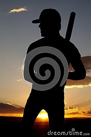 Silhouette baseball standing sunset