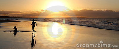 Silhouette beach image at sunset