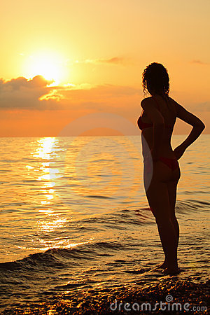Silhouette beautiful woman standing on beach