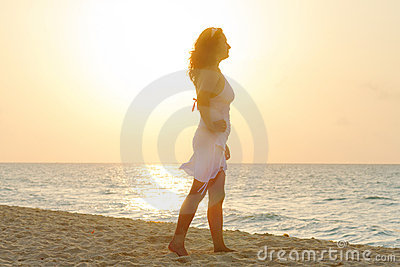 Silhouette of beautiful woman at sunrise