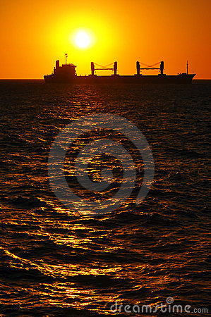 Silhouette of a Boat at Sunset