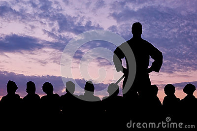 Silhouette of a border guard and detained refugees Stock Photo