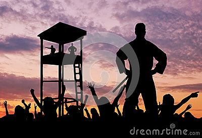 Silhouette of border guards and refugees Stock Photo