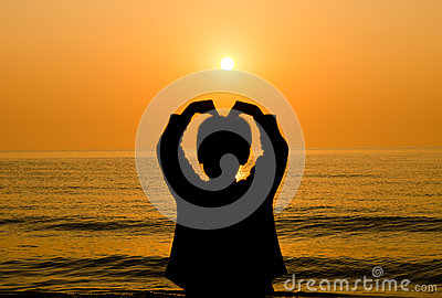 Silhouette Boy hand making a heart shape