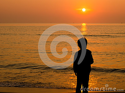 Silhouette Boy standing on the beach
