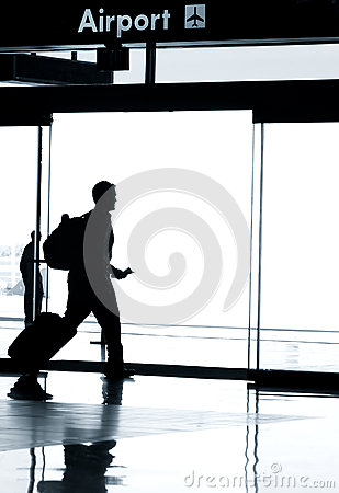 Silhouette of business man walking in airport