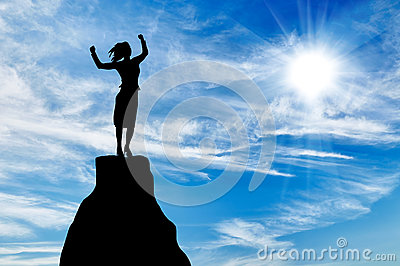 Silhouette business woman at the peak of the mountain Stock Photo
