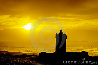 Silhouette of castle at sunset in Ireland.