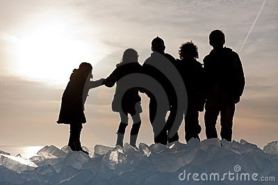 Silhouette of children on Ice hummocks at sunset