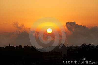 A silhouette of city skyline on sunset