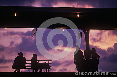 Silhouette of commuters on train platform Editorial Stock Photo