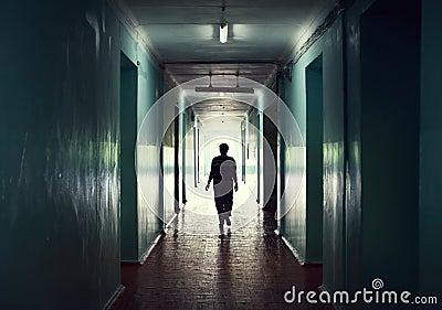 Silhouette in a corridor