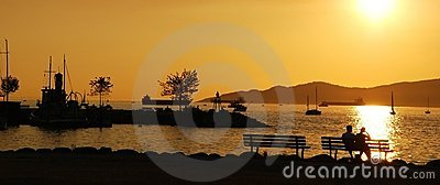 Silhouette of a couple enjoy beautiful sunset view