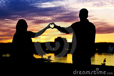 Silhouette of couple heart shaped