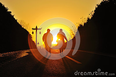 Silhouette couple on the sunset