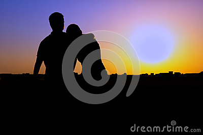 Silhouette of couple watching the sunset
