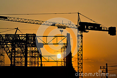 Silhouette crane building and sunset