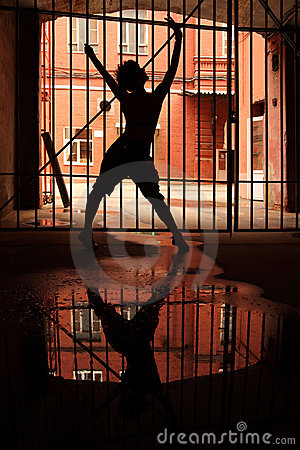 Silhouette of dancing girl in dark