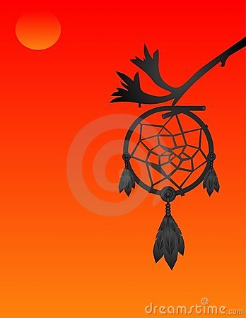 Silhouette of a dream catcher at sunset