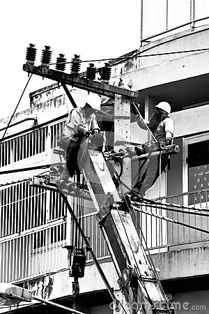 Free Silhouette Electrician Working On Electricity Post Stock Image - 30002271