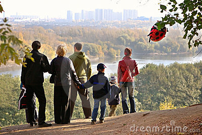 Silhouette of family admiring an autumn decline