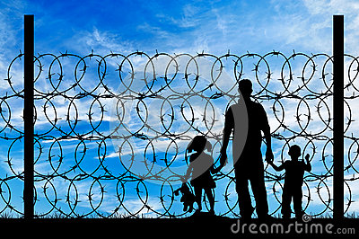 Silhouette of a family with children refugees Stock Photo