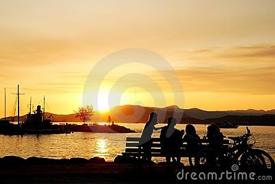Silhouette of a family enjoy beautiful sunset view