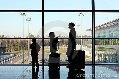 Silhouette of family with luggage