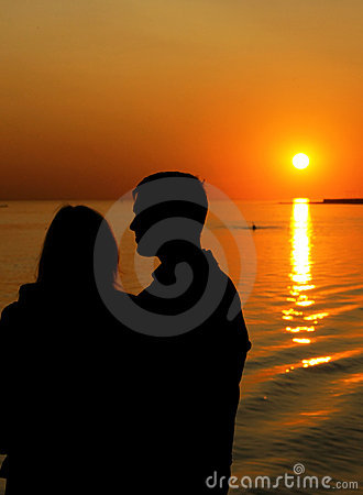 Silhouette of family in sunset