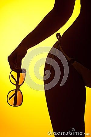 Silhouette of female body with bikini