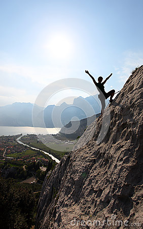Silhouette of a female rock climber