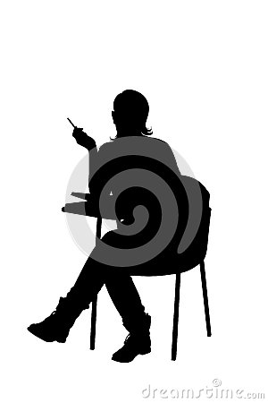 A silhouette of a female sitting on a school chair