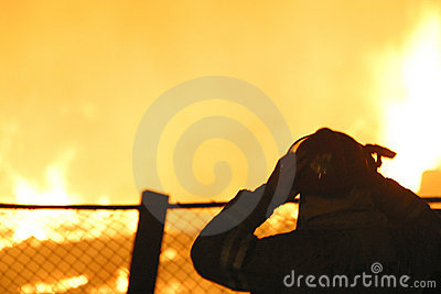 Silhouette of firefighter at a blaze