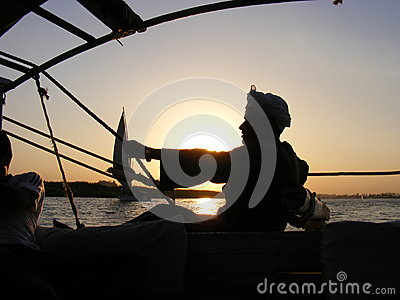 Fisherman on boat Editorial Stock Image