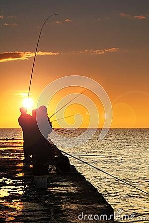 Silhouette of fishermen